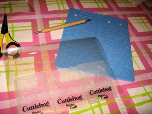 Dry embossing materials