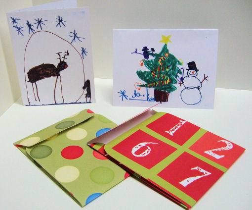 Card's made with my kid's artwork and an envelope cut with my Cricut!