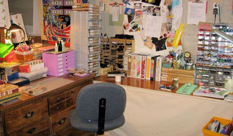 "I call this area ""The Cockpit"" I have all of my inks, stamps, pens, markers and adhesive at arms reach. What a mess!"