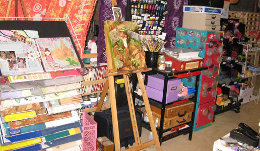 Here is a posterboard rack I got for $10 when a rite aid went out of business, my painting supplies, file cabinet and yarn storage.