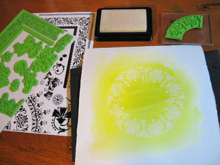 Stamp and emboss on watercolor paper then paint with a light color of watercolor paint.