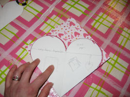 Place the template on top and trace, line ip the point of the heart with the folded paper and the bumps with the open paper.