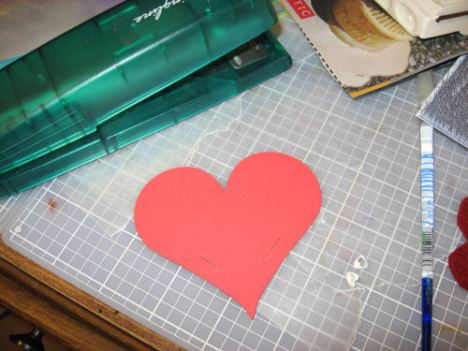 Stack the hearts and staple them on each side as shown.