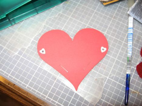 Add eyelets to the sides (or just staple it), decorate it and insert a lollipop. Easy as pie!