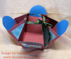"This box is made by scoring the 12"" paper at 4"" and 8"" on each side and pulling the corners up with ribbon."