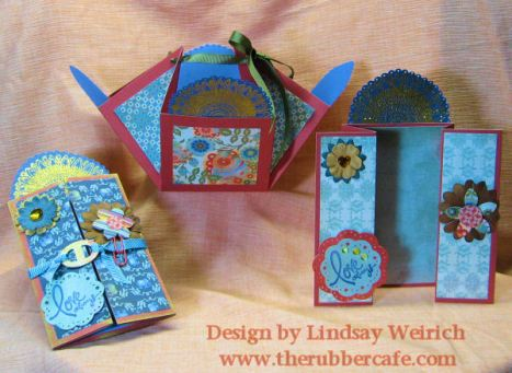 Stamps: TheRubber Cafe, Paper: Basic Grey, Cardstock: DCWV, Dew Droplets: Robin's Nest,Tool: Scor-Pal