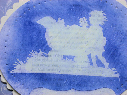 Close up of the gesso and embossed image, love how the text shows though!