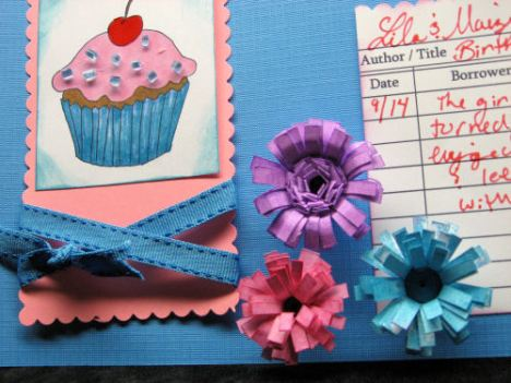 Quilled flowers add texture to the page.
