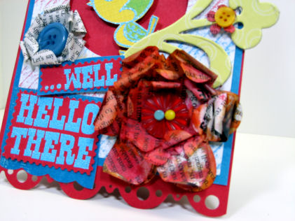 Check out the flowere: I die cut floeres (Sizzix) from an old NewsWeek magazine, curled the petals and sprayed them with my homemade shimmer spray, try it, it's fun!