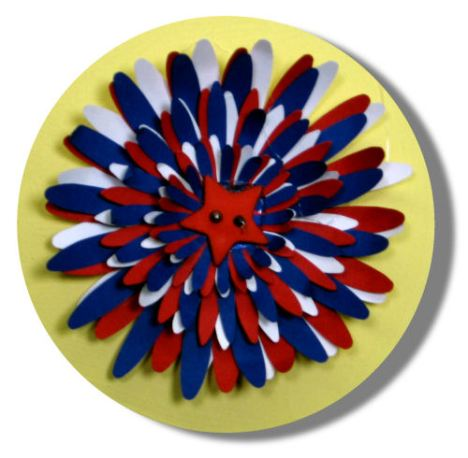 I die cut the flowers with my Ellison Daisy die from red, white and blue cardstock and curled the petals before adhereing with hot glue.