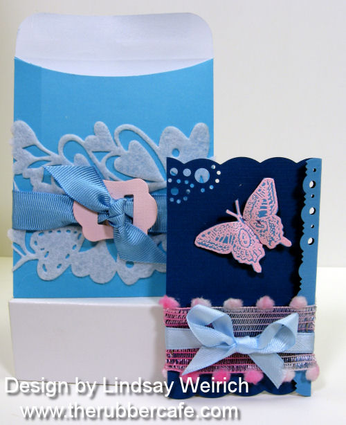 Stamps: The Rubber Cafe, Die Cuts/Cardstock: Creative Cuts and More, Die cut felt: Queen & Co.,Pockets/ribbon: The Dollar Tree