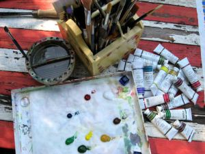 When using artist quality acrylic paint you don't need a lot, this is more than enough to paint the table top!