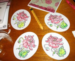 Color the stamped images loosely with the watercolor crayons, the blend with a damp brush or blender pen.