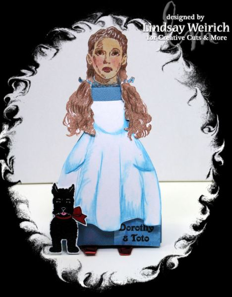 For Dorothy I used the dress box in blue and hand-drew an apron, cut out and added it with stamped elements.