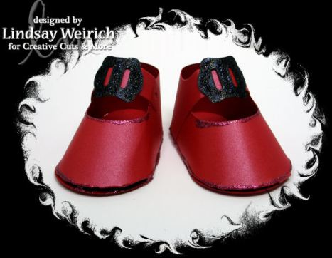 Don't forget the ruby slippers! These were cut from Metallic red cardstock, I stickled the buckles and glued them on.