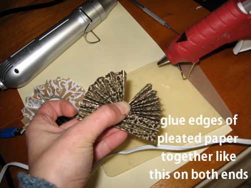 After you glue the edges together you need to squirt a dab of glue in the middle and hold it until it cools.