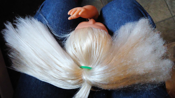 how to make a dolls hair smooth