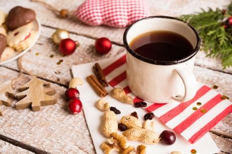 graphicstock-christmas-composition-cup-of-coffee-dried-fruit-cranberries-and-nuts-various-objects-laid-on-table-studio-shot-wooden-background_Buu7mQhBz-.jpg